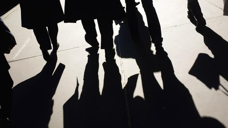 People walk along Madison Avenue on Nov. 1, 2011 in New York City. (Photo by Spencer Platt/Getty)