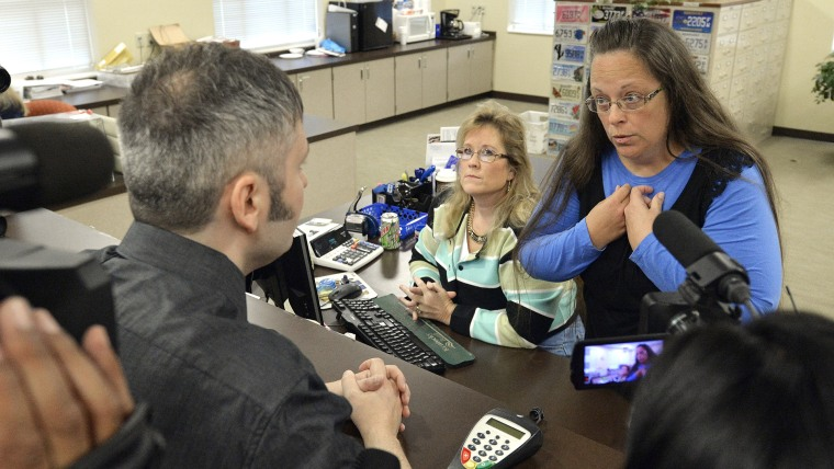 Rowan County Clerk Kim Davis, right, talks with David Moore following her office's refusal to issue marriage licenses at the Rowan County Courthouse in Morehead, Ky. on Sep. 1, 2015. (Photo by Timothy D. Easley/AP)