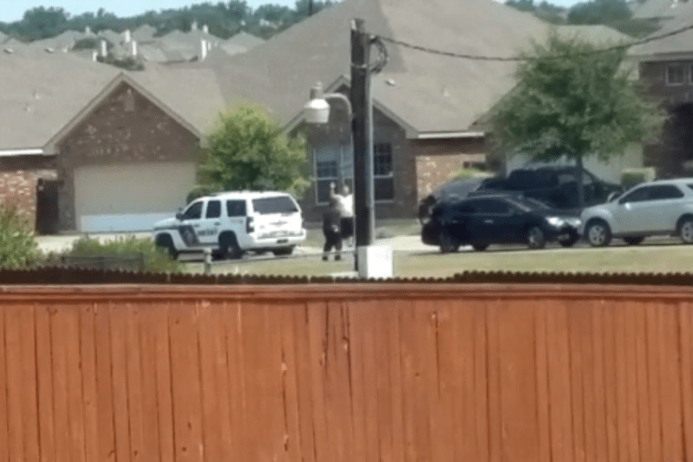 Bystander Michael Thomas captured this video of Gilbert Flores, 41, in which he appears to raise his hands before being shot by police just before noon on Aug. 28 in San Antonio, Texas.