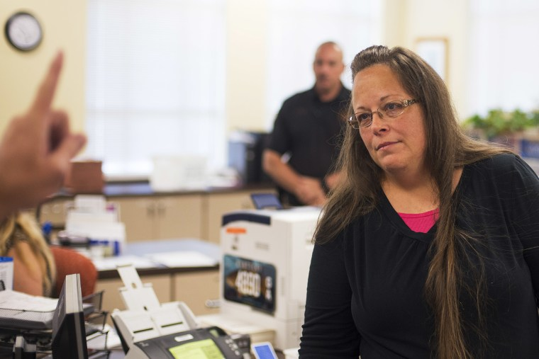 Kim Davis, the Rowan County Clerk of Courts, listens as a couple speaks with her about getting a marriage license at the County Clerks Office on September 2, 2015 in Morehead, Kentucky. (Photo by Ty Wright/Getty)