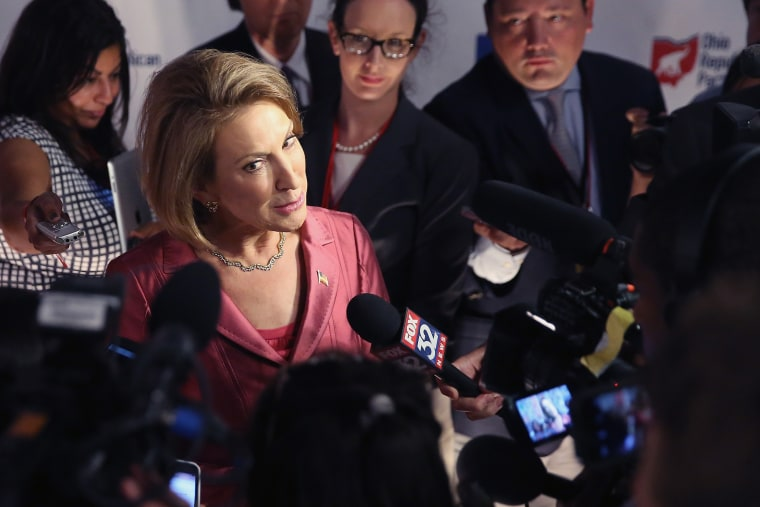 "Republican presidential candidate Carly Fiorina fields questions from the press following the ""happy hour"" debate hosted by Fox News at the Quicken Loans Arena August 6, 2015 in Cleveland, OH. (Photo by Scott Olson/Getty)"