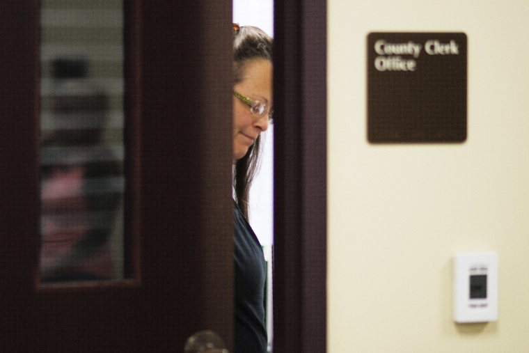 Kim Davis, the Rowan County Clerk of Courts, closes the door to her office after denying a marriage license at the County Clerks Office on September 2, 2015 in Morehead, Kentucky. (Photo by Ty Wright/Getty)