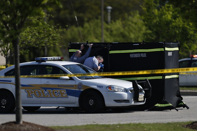 Authorities collect evidence and investigate a police involved shooting in a Wal-Mart parking lot on Wednesday, April 22, 2015 in Portsmouth, Va. (Photo by Stephen M. Katz/The Virginian-Pilot/AP)