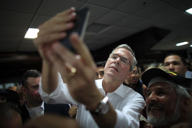 Former Florida Gov. Jeb Bush takes a selfie with a supporter's phone in Bayamon, Puerto Rico, Tuesday, April 28, 2015. (Photo by Ricardo Arduengo/AP)