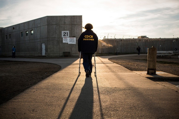 George Whitfield, age 56 and in prison for marijuana-related charges, uses a walker to walk back to his cell block at California State Prison, Solano, on December 16, 2013 in Vacaville, California. (Photo by Andrew Burton/Getty)