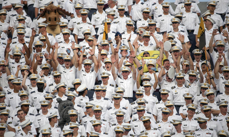 Cadets cheer during the first half of an NCAA college football game between Army and Fordham in West Point, N.Y. More than a dozen students were injured during the annual pillow fight by first year cadets on Aug. 20, 2015. (Photo by Mike Groll/AP)