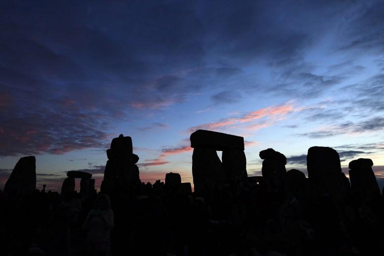 The Stonehenge monument on Salisbury Plain, southern England at sunrise.