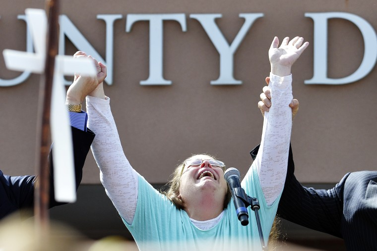 Rowan County Clerk Kim Davis cries out after being released from the Carter County Detention Center, Tuesday, Sept. 8, 2015, in Grayson, Ky. (Photo by Timothy D. Easley/AP)