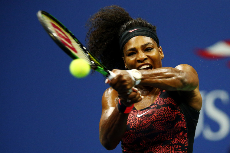 Serena Williams returns a shot to Venus Williams, both of the United States, during their Women's Singles Quarterfinals match on Day Nine of the 2015 US Open on Sept. 8, 2015, New York City. (Photo by Clive Brunskill/Getty)