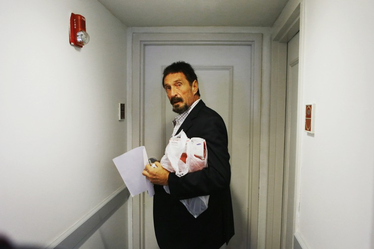 John McAfee enters a room at the Beacon Hotel where briefly stayed after arriving from Guatemala on December 13, 2012 in Miami Beach, Florida. (Photo by Joe Raedle/Getty)