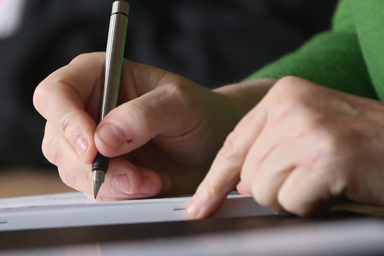 Writing. (Photo by Sean Gallup/Getty)