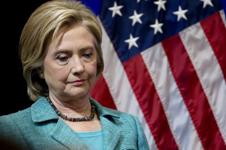 Democratic presidential candidate Hillary Clinton pauses as she is introduced to speak at the Brookings Institution in Washington on Sept. 9, 2015. (Photo by Carolyn Kaster/AP)