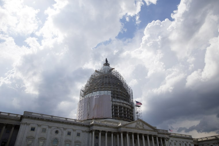 Storm clouds pass near the US Capitol Building, in Washington DC on June 1, 2015. (Photo by Michael Reynolds/EPA)