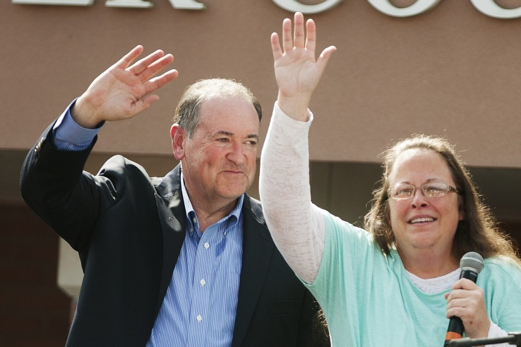 Republican presidential candidate Mike Huckabee (L) stands behind Rowan County Clerk of Courts Kim Davis (R) in front of the Carter County Detention Center on September 8, 2015 in Grayson, Kentucky. (Photo by Ty Wright/Getty)