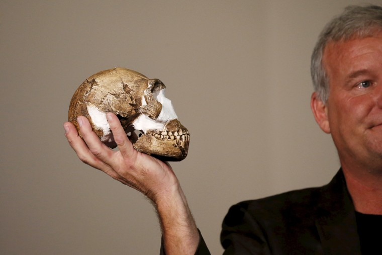 """Professor Lee Berger holds a replica of the skull of a newly discovered ancient species, named """"Homo naledi"""", during its unveiling outside Johannesburg, South Africa on Sept. 10, 2015. (Photo by Siphiwe Sibeko/Reuters)"""