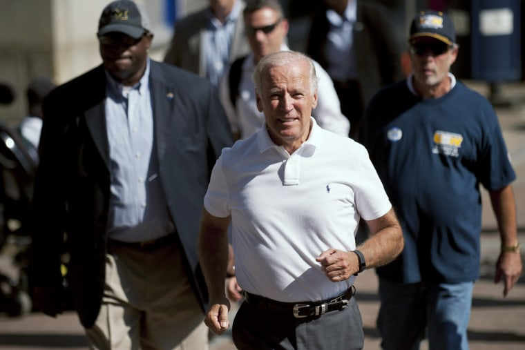 Vice President Joe Biden runs while participating in the annual Allegheny County Labor Day Parade, Sep. 7, 2015 in Pittsburgh, Penn. Biden has been subject of speculation about whether he will run for the U.S. presidency. (Photo by Jeff Swensen/Getty)