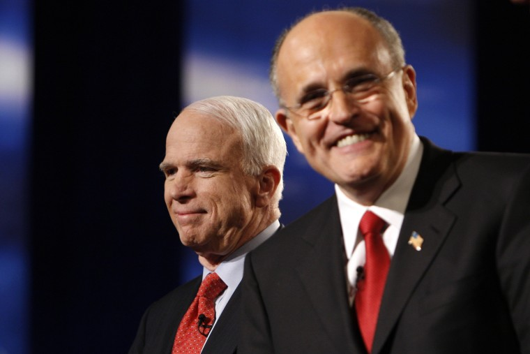 Former US Republican presidential candidates John McCain and Rudy Giuliani smile before the MSNBC Republican presidential debate in Boca Raton, Florida, January 24, 2008. (Photo by Carlos Barria/Reuters)