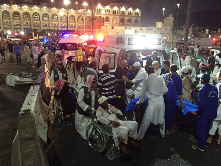 Paramedics and officials hospitalize wounded people after a construction crane collapsed over the Muslim pilgrims around the Muslims' holy place Kaaba in Mecca, Saudi Arabia on Sep. 11, 2015. (Photo by Ozkan Bilgin/Anadolu Agency/Getty)