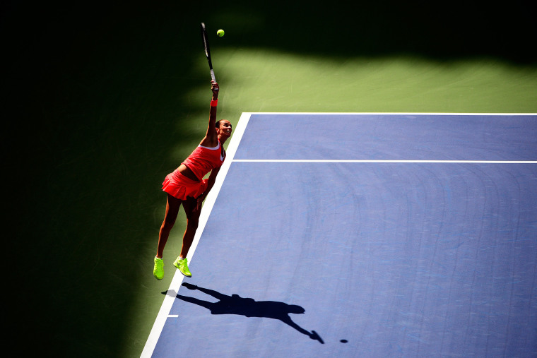 Roberta Vinci of Italy serves to Serena Williams of the United States during their Women's Singles Semifinals match on Day Twelve of the 2015 US Open on September 11, 2015. (Photo by Alex Goodlett/Getty)