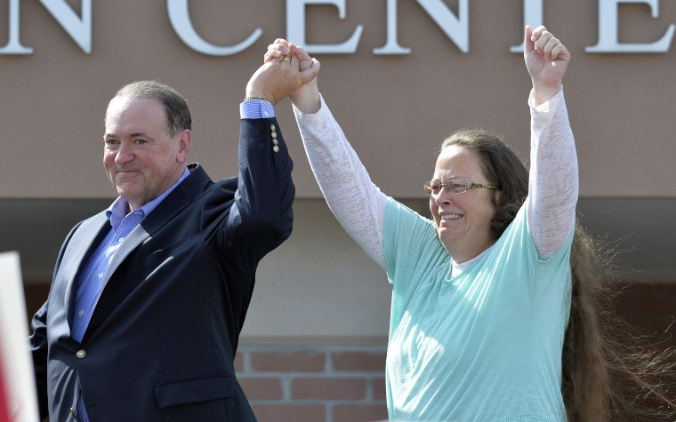 Rowan County Clerk Kim Davis, with Republican presidential candidate Mike Huckabee at her side, greets the crowd after being released from the Carter County Detention Center, Sep. 8, 2015, in Grayson, Ky. (Photo by Timothy D. Easley/AP)