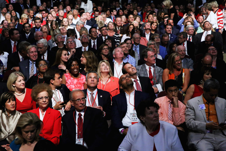 Audience members wait for the start of a Republican presidential debate hosted by FOX News and Facebook at the Quicken Loans Arena August 6, 2015 in Cleveland, Ohio. (Photo by Chip Somodevilla/Getty)