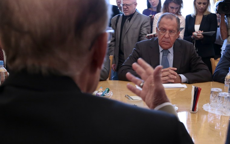Russian Foreign Minister Sergey Lavrov listens to Qadri Jamil, former deputy prime minister representing Syria's opposition Popular Front of Change and Liberation during a meeting in Moscow, Russia, Aug. 31, 2015. (Photo by Ivan Sekretarev/AP)