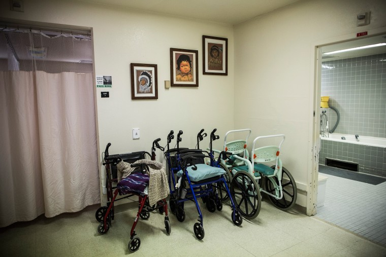 Walkers sit in a corner of the hospice care wing at California Medical Facility (CMF) on Dec. 17, 2013 in Vacaville, Calif. (Photo by Andrew Burton/Getty)
