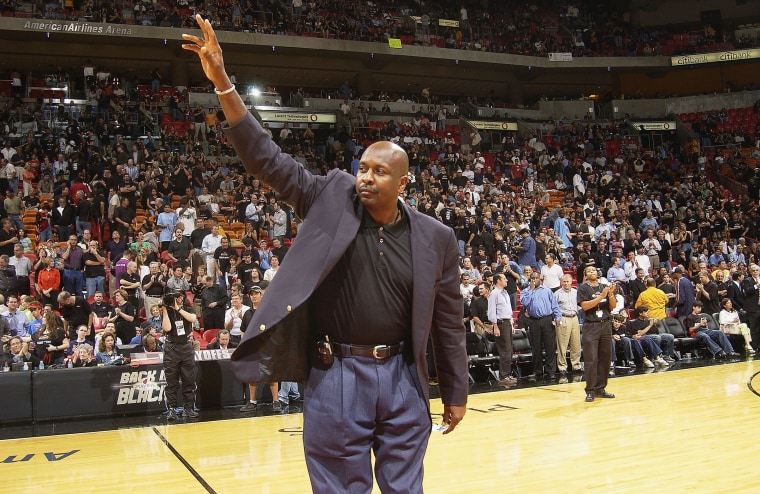 NBA Legend Moses Malone salutes the crowd during the NBA Legends tour's stop in Game four of the Eastern Conference Semifinals during the 2004 NBA Playoffs at the American Airlines Arena, on May 12, 2004 in Miami. (Photo by Issac Baldizon/NBAE/Getty)