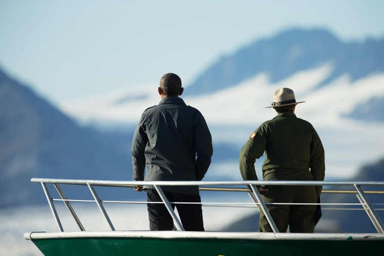 President Barack Obama and a National Park Service employee look at Bear Glacier, which has receded 1.8 miles in approximately 100 years, Tuesday, Sept. 1, 2015, in Seward, Alaska. (Photo by Andrew Harnik/AP)