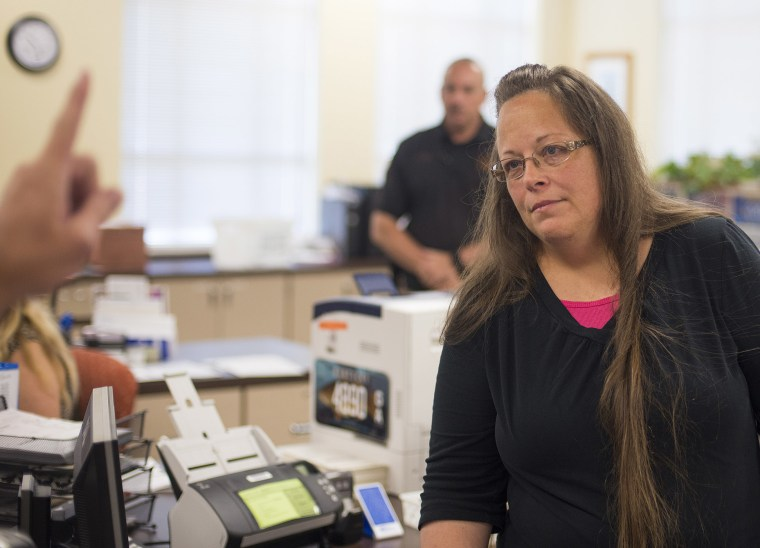Kim Davis, the Rowan County Clerk of Courts, listens to Robbie Blankenship and Jesse Cruz as they speak with her about getting a marriage license at the County Clerks Office on Sep. 2, 2015 in Morehead, Ky. (Photo by Ty Wright/Getty)