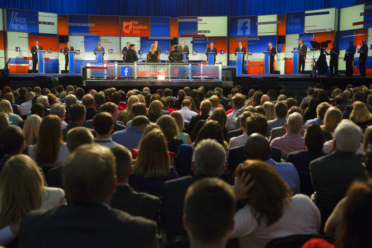 Republican presidential candidates take the stage for the first Republican presidential debate at the Quicken Loans Arena, Aug. 6, 2015, in Cleveland. (Photo by John Minchillo/AP)