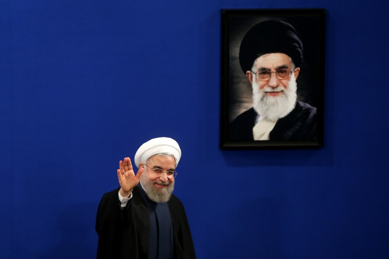 Iran's President Hassan Rouhani waves to reporters at the conclusion of his press conference in Tehran, Iran, Aug. 29, 2015. (Photo by Ebrahim Noroozi/AP)