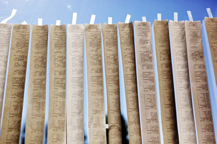 Sample ballots from digital voting machines are taped to a window during the presidential primary election on April 3, 2012 in Potomac, Maryland. (Photo by Chip Somodevilla/Getty)