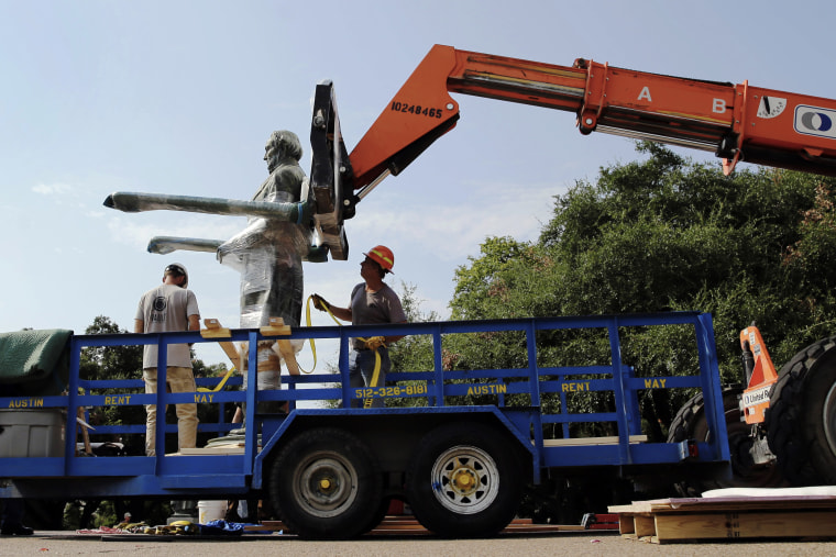 A statue of Confederate President Jefferson Davis is moved from its location in front of the school's main tower the University of Texas campus, Sunday, Aug. 30, 2015, in Austin, Texas. (Photo by Eric Gay/AP)
