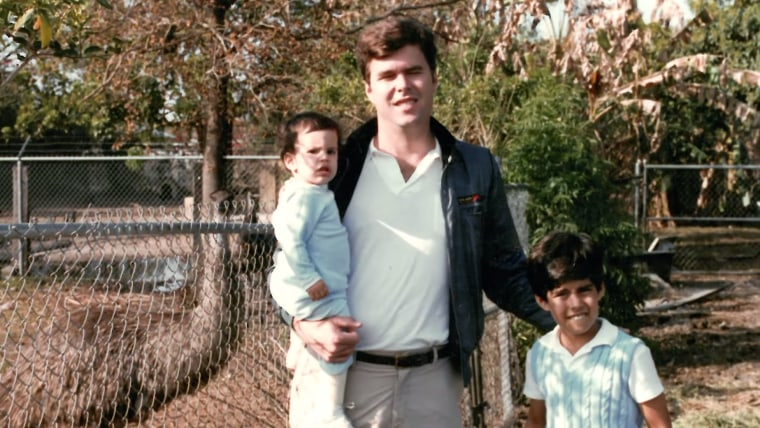 """Jeb Bush poses with two of his children in a family photo from 1990, as shown in his latest campaign video, """"Todos Somos Americanos"""" released on YouTube, Sept. 14, 2015."""