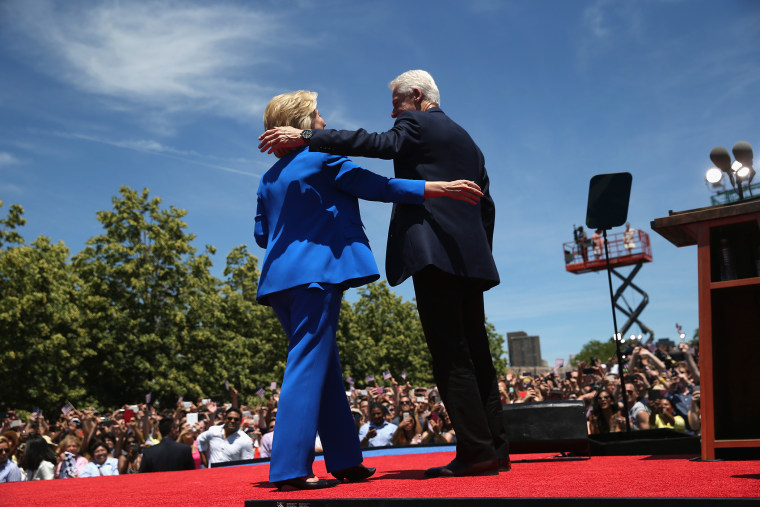 Democratic Presidential candidate Hillary Clinton and former President Bill Clinton embrace after Hillary officially launched her presidential campaign at a rally on June 13, 2015 in New York City. (Photo by John Moore/Getty)