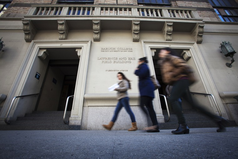 People walk past Baruch College in New York, Dec. 12, 2013. (Photo by Carlo Allegri/Reuters)