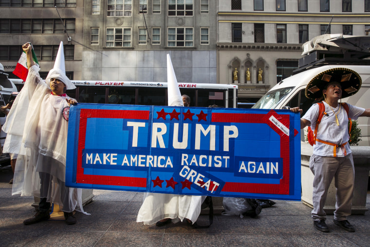 Demonstrators stand outside of Trump Towers to protest Donald Trump's candidacy for U.S. President in NY, Sept. 3, 2015.
