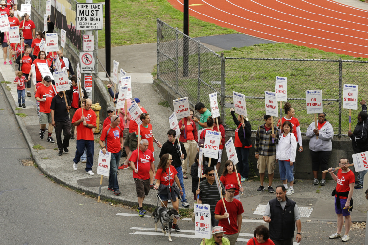 Striking Seattle School District teachers and other educators walk a picket line, Thursday, Sept. 10, 2015, near Franklin High School in Seattle. (Photo by Ted S. Warren/AP)