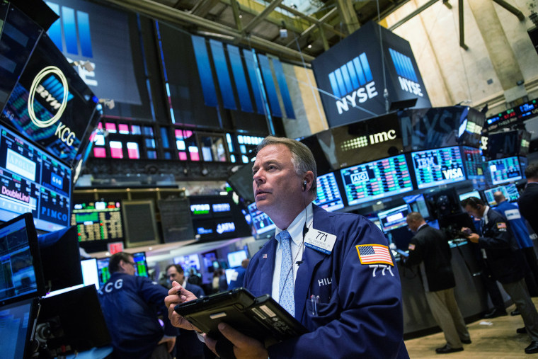 A trader works on the floor of the New York Stock Exchange during the afternoon of Sept. 8, 2015 in New York, N.Y. (Photo by Andrew Burton/Getty)