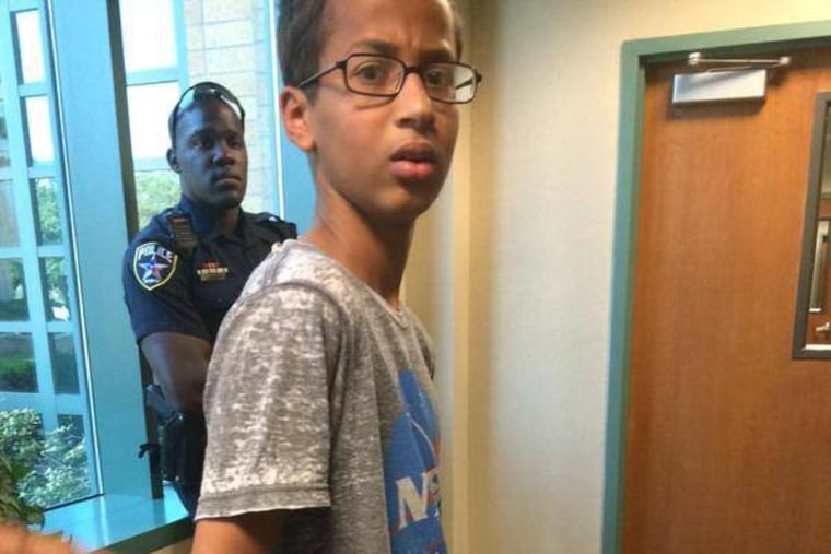 """Ahmed Mohamed, A 14-year-old North Texas student, appears in handcuffs, after his arrest on charges of making a \""""hoax bomb.\"""""""