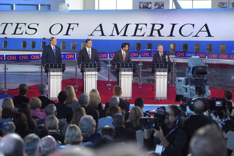 Republican presidential candidates appear during the CNN Republican presidential debate at the Ronald Reagan Presidential Library and Museum on Sept. 16, 2015, in Simi Valley, Calif. (Photo by Mark J. Terrill/AP)