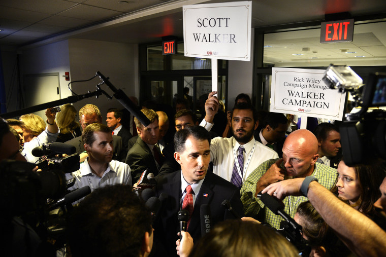 Republican presidential candidate Scott Walker meets the media in the Spin Room following the second GOP Presidential candidates debate at the Ronald Reagan Presidential Library in Simi Valley, Calif., Sept. 16, 2015. (Photo by Mike Nelson/EPA)