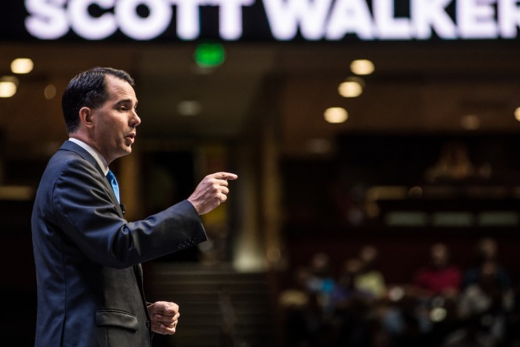 Wis.n Governor and republican presidential candidate Scott Walker speaks to voters at the Heritage Action Presidential Candidate Forum on Sept. 18, 2015 in Greenville, S.C. (Photo by Sean Rayford/Getty)