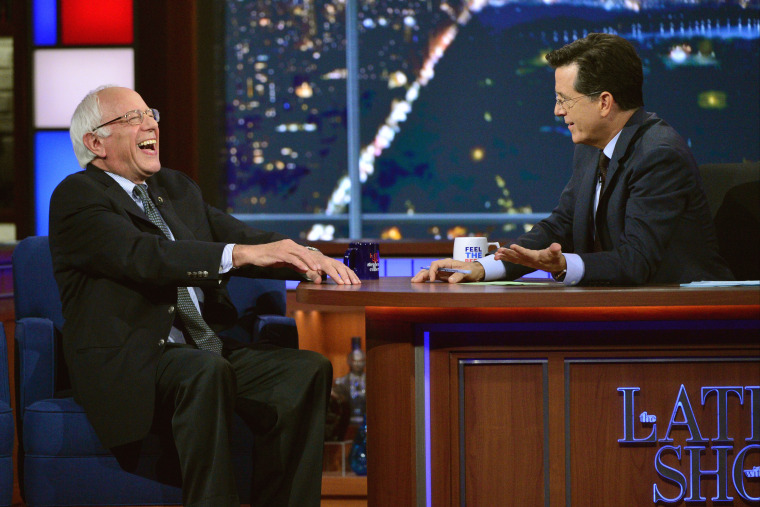 "Senator and Democratic candidate for president, Bernie Sanders, left, joins host Stephen Colbert on the set of ""The Late Show with Stephen Colbert,"" on Sept. 18, 2015 in N.Y. (Photo by John Paul Filo/CBS/AP)"