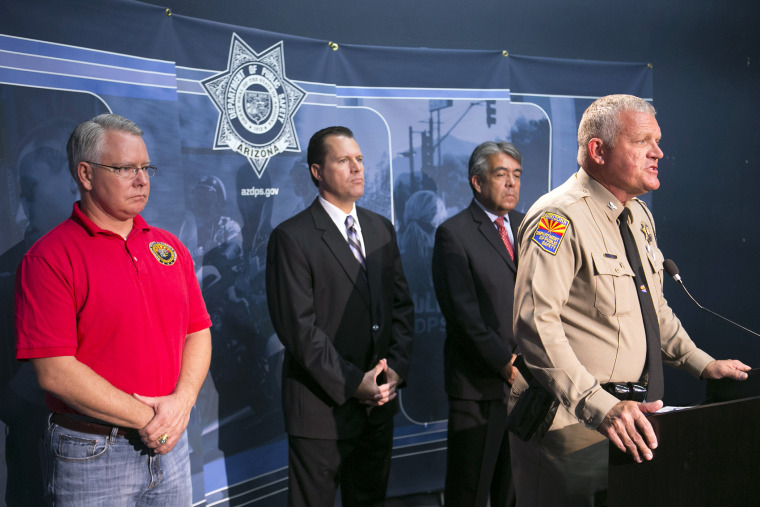 Colonel Frank Milstead, Director of Department of Public Safety holds a press conference to announce the arrest of a suspect in the Phoenix freeway shootings, at DPS headquarters, Sept.18, 2015. (Photo by David Wallace/The Arizona Republic/AP)