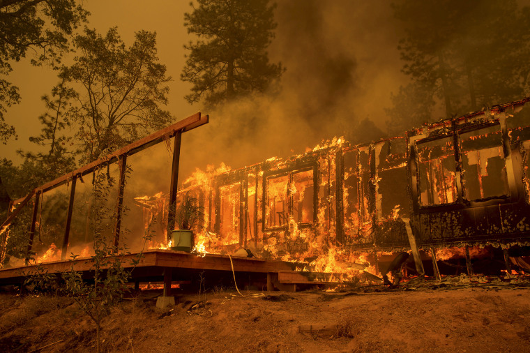 A home burns as the Butte Fire rages near Mountain Ranch, Calif., Sept. 11, 2015. (Photo by Noah Berger/Reuters)