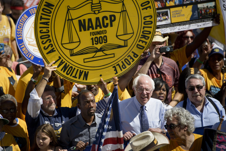 Presidential hopeful Bernie Sanders and Cornell William Brooks, president and CEO of the NAACP walk up the steps of the Lincoln Memorial during the march from Selma, Ala. to Washington, DC Sept. 15, 2015. (Photo by Brendan Smialowski/AFP/Getty)