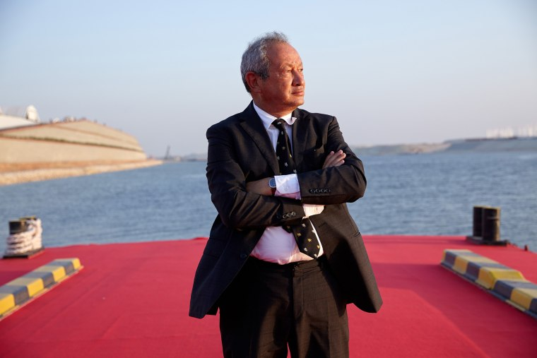 Egyptian billionaire Naguib Sawiris poses for a photograph on a floating pontoon in front of the New Suez Canal, operated by the Suez Canal Authority, in Ismailia, Egypt, Aug. 6, 2015. (Photo by Shawn Baldwin/Bloomberg/Getty)