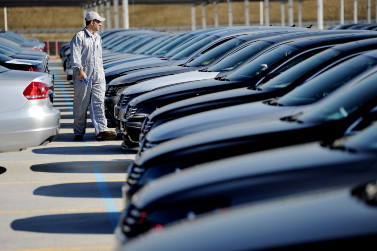 An employee looks over cars at the Volkswagen automobile assembly plant in Chattanooga, Tenn., on Feb. 21, 2012. (Photo by Erik S. Lesser/EPA)